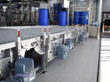Automated filling machine and conveyor system